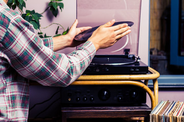 Man placing record on turntable