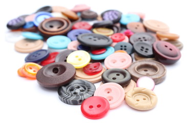 Collection of various sewing buttons on white background