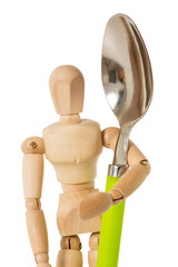 Wooden mannequin holding large green spoon, isolated