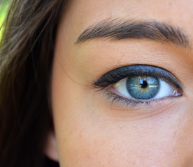 Beautiful blue woman eye closeup