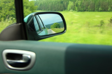 road car rear view mirror motion blur background