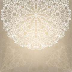 Beautiful wedding card with white lace round ornament on an old