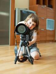 child takes photo with tripod