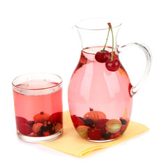 Pitcher of compote with summer berries isolated on white