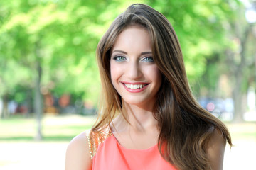 Beautiful young woman in summer park