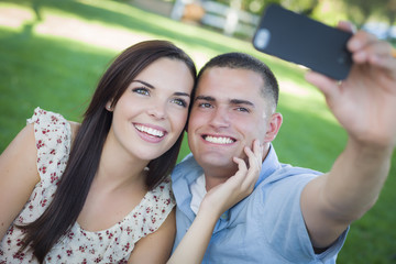 Mixed Race Couple Taking Self Portrait in Park