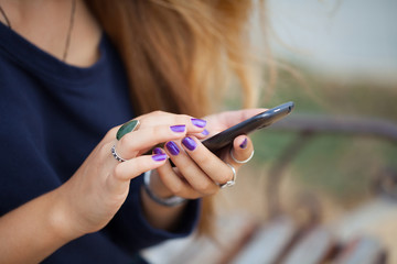 Close up of a girl using mobile smart phone