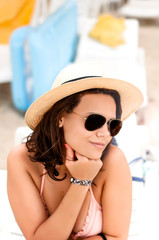 woman with hat having fun in summer vacation on beach