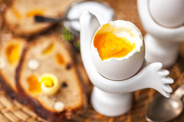 Soft-boiled egg, whole wheat bread  with butter. Breakfast