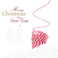 Bright Christmas composition with ribbon decorations and snow is