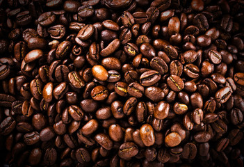 Roasted brown coffee beans  background or texture closeup. High