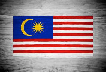 Malaysia flag on wood texture