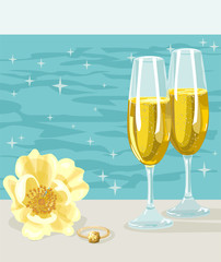 Two glasses of cold champagne, flower and ring
