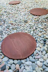 Brown brick on white stone in garden