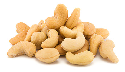 Heap of cashew nuts isolated on white background