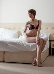 Lovely brunette with short hair posing in lingerie
