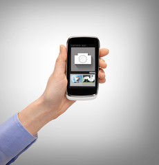 hand with smartphone showing application