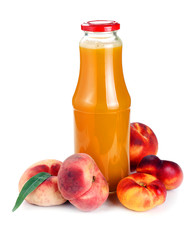 peach juice in a bottle and fruit