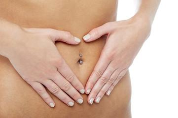 Woman's hands around pierced navel