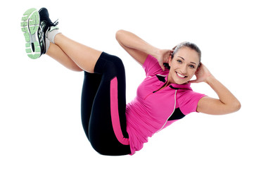Fit smiling woman doing crunches