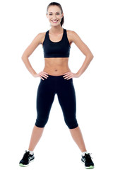 Slim athletic woman posing with a radiant smile