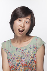 Portrait of surprised and shocked woman, studio shot