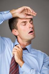 Businessman pulling his collar