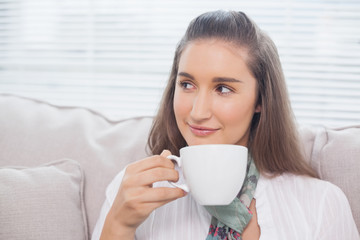 Peaceful cute model holding coffee