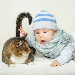 Child and cat, baby playing with pet - no allergy!