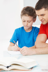 Father and son. Father helping his son with homework
