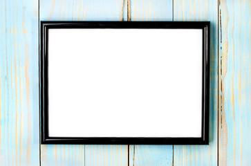 photo frame on wooden blue background