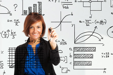 Woman writing formulas