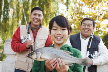 Multi-generational men fishing portrait