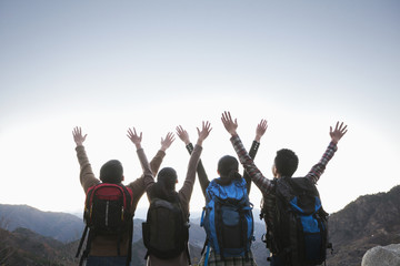 Group of people standing with hands outstretched