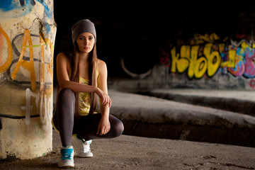 Teenage girl with gray hat in front of graffiti wall Wall mural