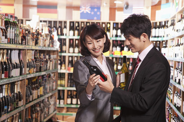 Couple Choosing Wine in a Liquor Store