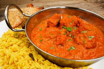 Chicken tikka masala in balti dish with rice