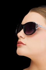Pensive classy blonde wearing sunglasses