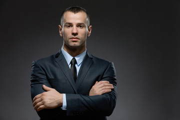 Half-length portrait of man wearing business suit