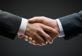 Close up of hand shake of business people
