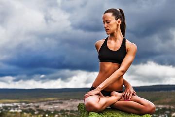 Beautiful slim woman do yoga twist pose