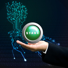 Start button on manager hand, Technology background