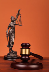 judge gavel  scales and lady of justice on table