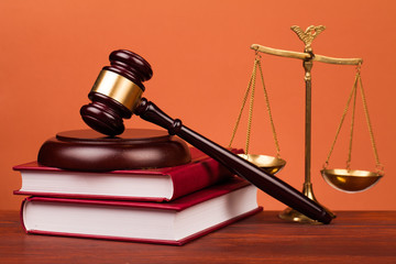 judge gavel,books and scales of justice on table