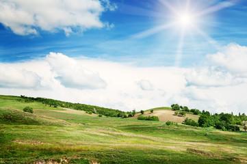 Spoed Fotobehang Blauw Mountainous terrain and the blue sky