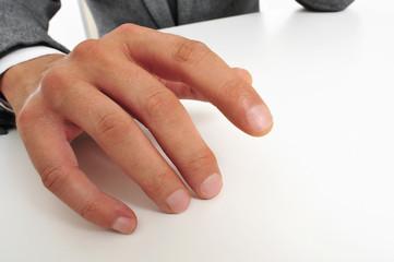 man in suit drumming his fingers