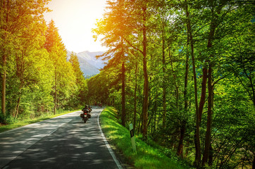 Fototapete - Biker on mountainous road