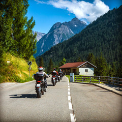 Wall Mural - Group of bikers on the road in Alps