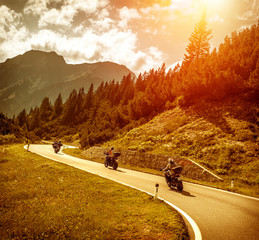Fototapete - Bikers on mountains road in sunset