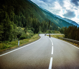 Fototapete - Group of bikers on mountainous road